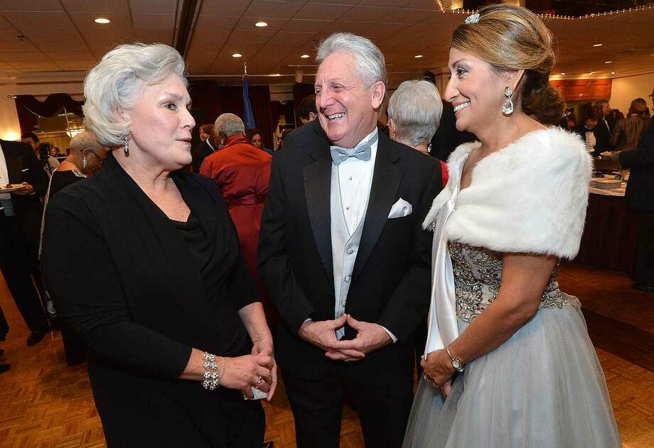 Hour Photo/Alex von KleydorffIn this file photo from last year, Mayor Harry Rilling and Lucia Rilling mingle with guests and Person-to-Person Executive Director Ceci Maher during the cocktail reception before dinner at the Mayor's Ball at Continental Manor.