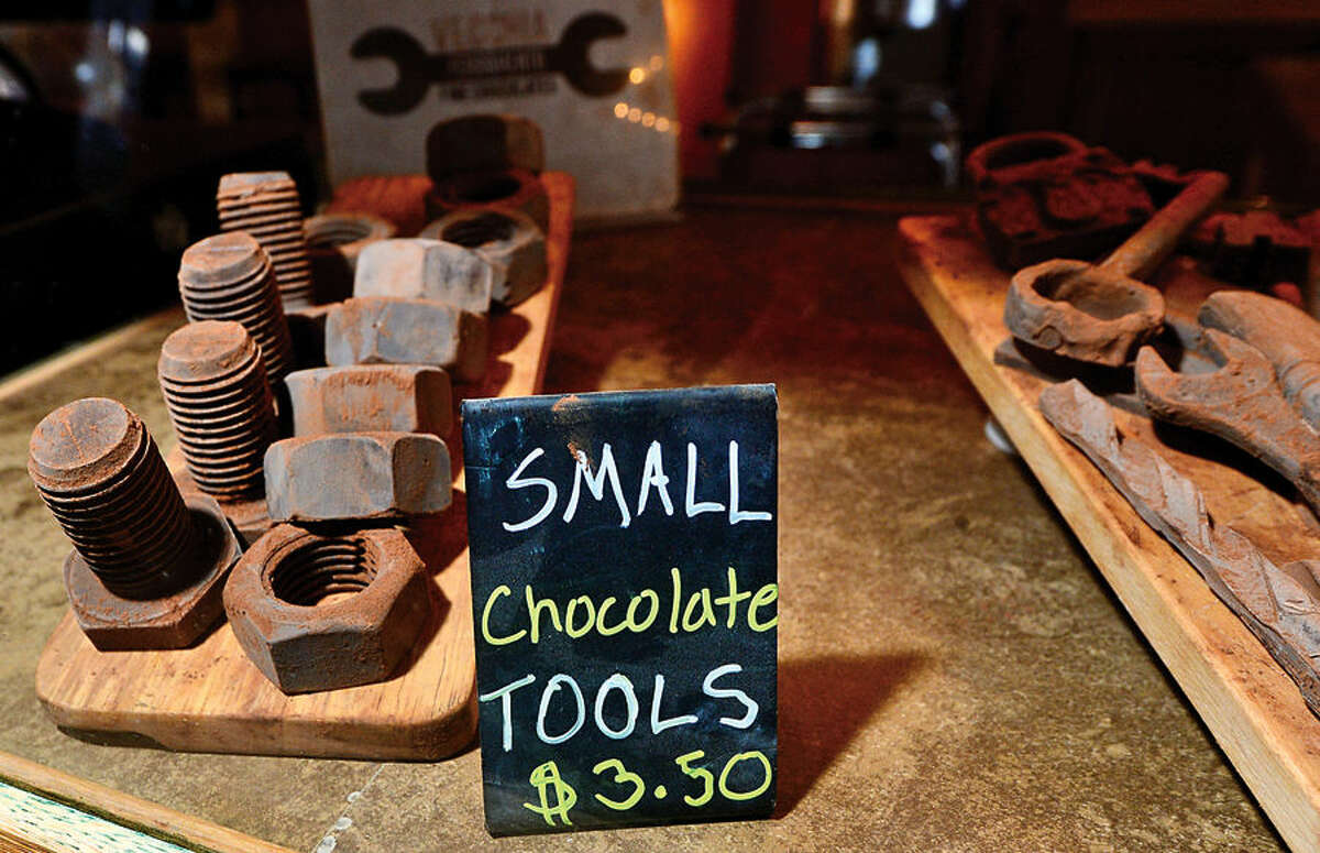 Hour photo / Erik Trautmann Romanacci's pizza restaurant owner, Graziano Ricci, makes hand-crafted chocolate tools, including hammers, wrenches and bolts, that are a favorite among his customers.