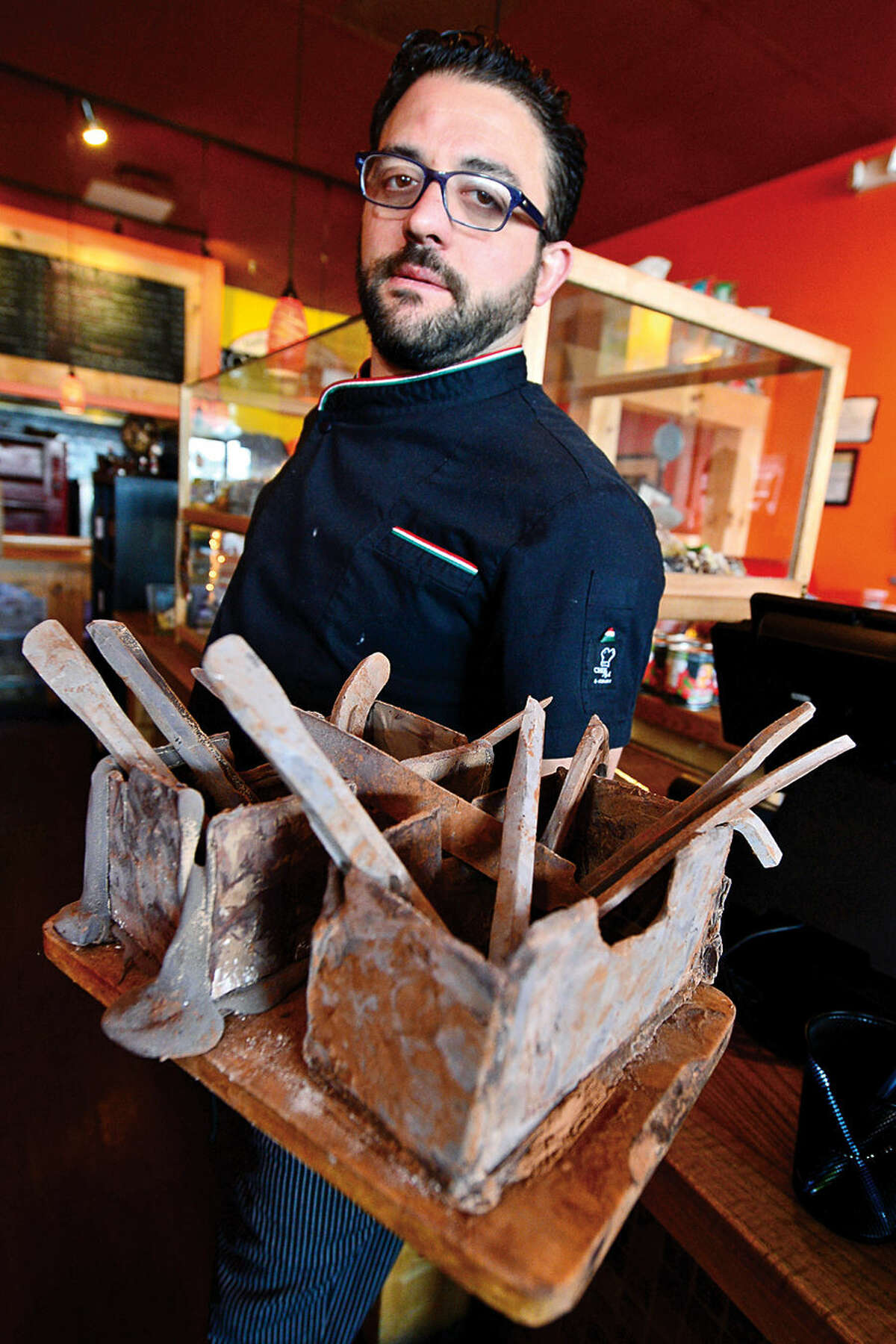 Hour photo / Erik Trautmann Romanacci's pizza restaurant owner, Graziano Ricci, makes hand-crafted chocolate tools, including hammers, wrenches, and bolts, that are a favorite among his customers.