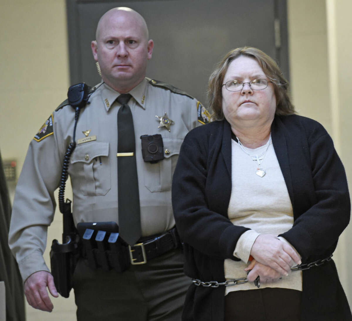 Joyce Hardin Garrard walks to the Etowah County Judicial Building from the Etowah County Detention Center in Gadsden, Ala. on Friday March 20, 2015. Garrard is accused of making her granddaughter run until she died. She faces capital murder charges. (AP Photo/The Gadsden Times, Eric T. Wright)