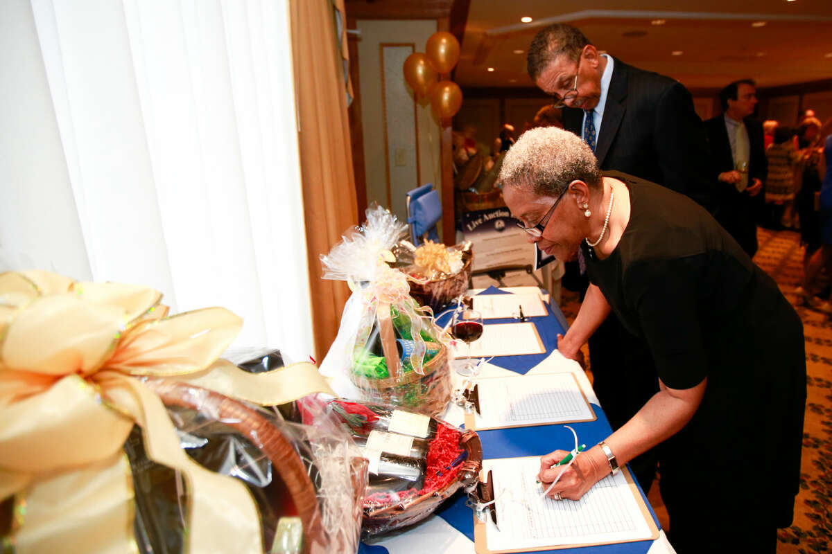 Hour photo/Chris Palermo. Juanita and Ron Watson place their bids in the silent auction at the Norwalk Seaport Association annual Lightkeeper's Gala at the Norwalk Inn Saturday night.