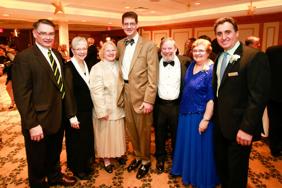 Hour photo/Chris Palermo. From left, GE Capital Real Estate Honoree Patrick Brennan, Diane Brennan, Lori Luton, GE Capital Real Estate Honoree James Lutton, Norwalk Seaport Association Captain Mark Schlegel and wife Pauline, and NSA President Vincent Scicchitano pose for a photo at the Norwalk Seaport Association annual Lightkeeper's Gala at the Norwalk Inn Saturday night.