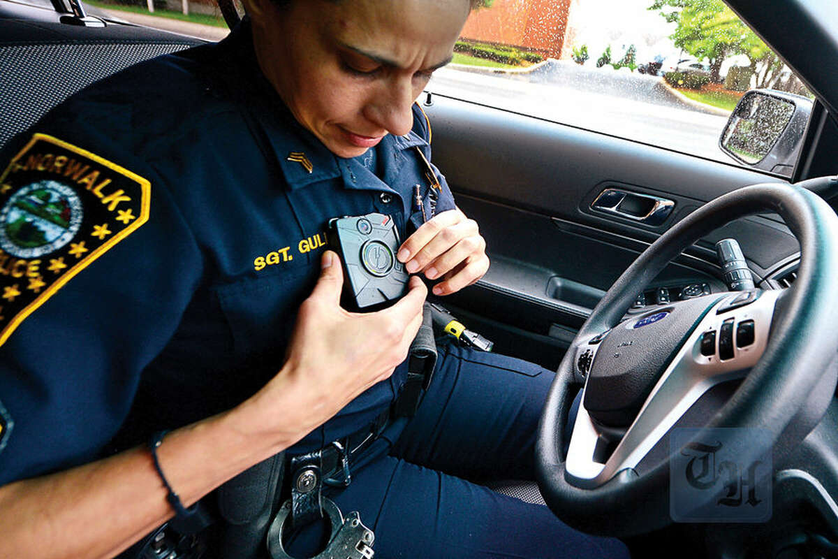 Hour photo / Erik Trautmann Norwalk police seargent Sophia Gulino wears a body camera during patrol as the department begins a training with the devices.