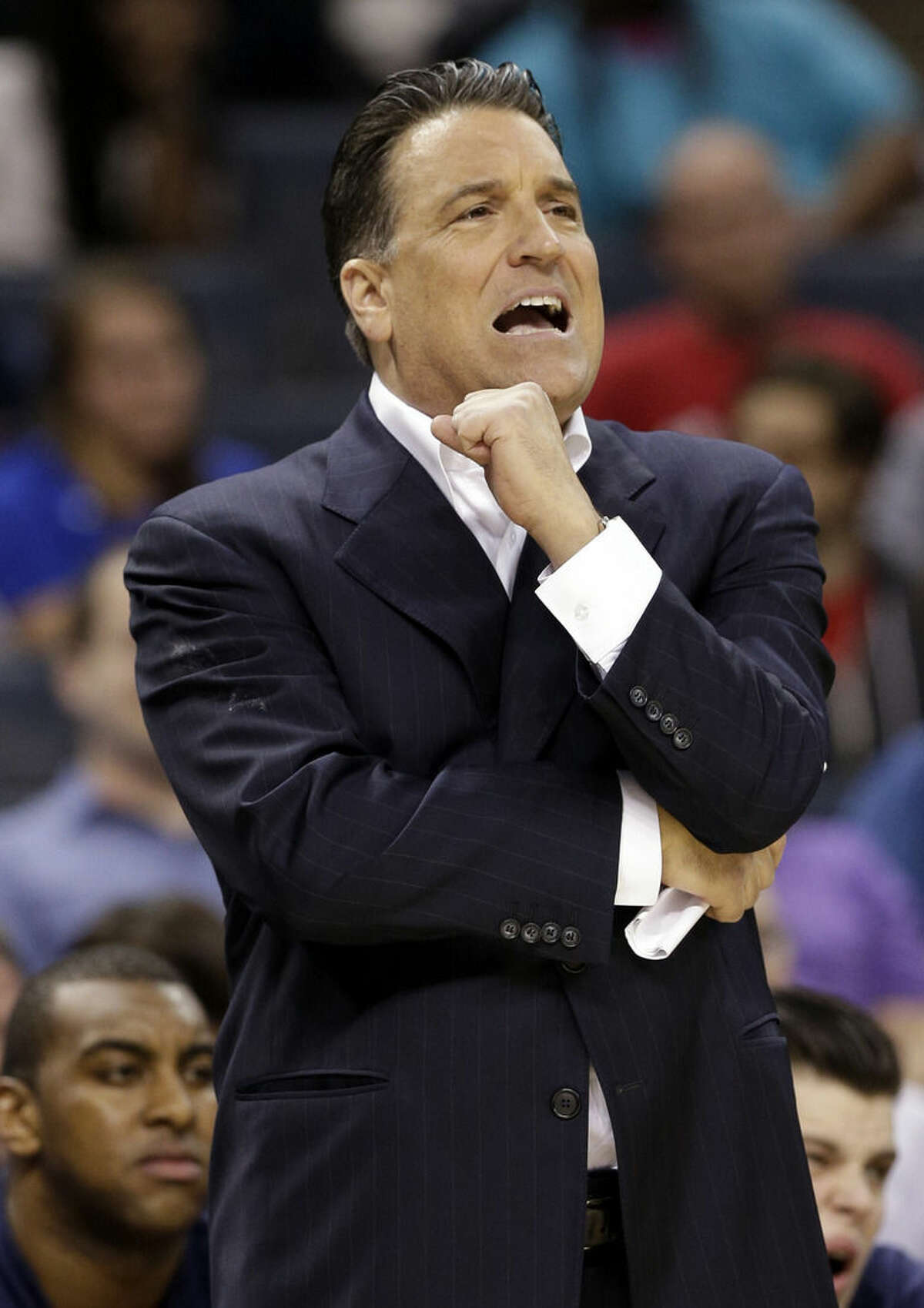 St. John's head coach Steve Lavin directs his team against San Diego State during the first half of an NCAA tournament college basketball game in the Round of 64 in Charlotte, N.C., Friday, March 20, 2015. (AP Photo/Nell Redmond)