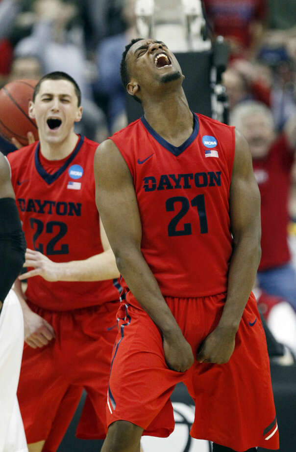 Dayton's Dyshawn Pierre (21) celebrates late in the second half of an NCAA tournament college basketball game against Providence in the Round of 64 in Columbus, Ohio, Saturday, March 21, 2015. Dayton won 66-53 behind Pierre's 20 points to advance to the Round of 32 against Oklahoma Sunday. (AP Photo/Paul Vernon)
