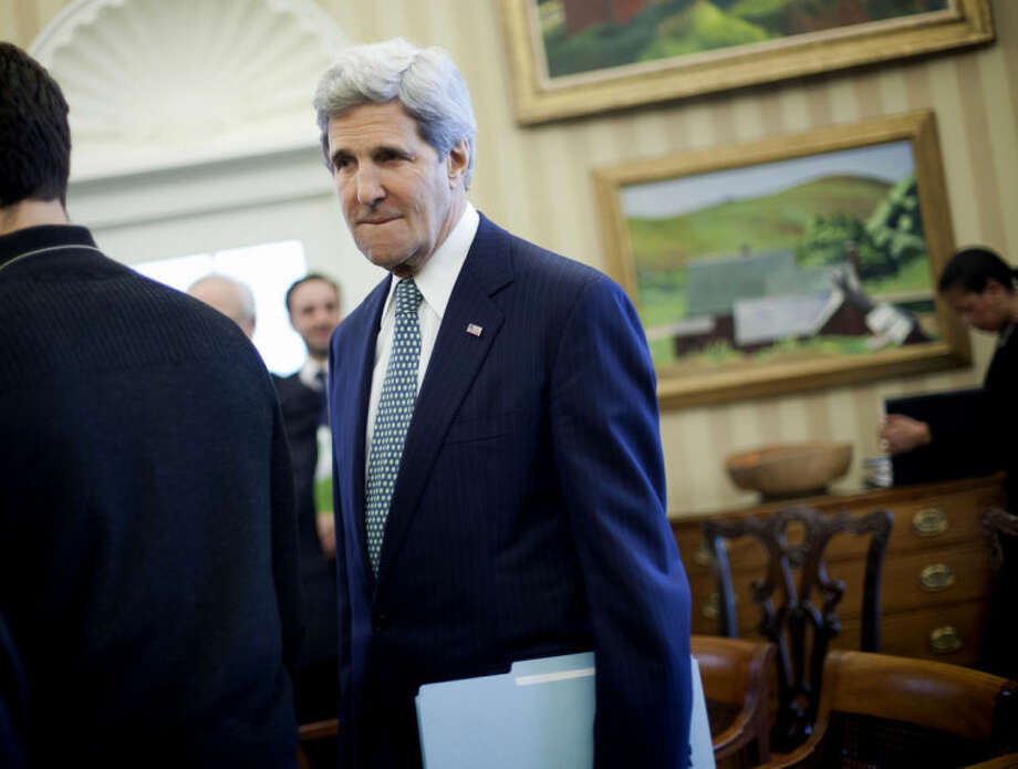 Secretary of State John Kerry is seen in the Oval Office of the White House in Washington, Monday, March 17, 2014, during President Barack Obama's meeting with Palestinian President Mahmoud Abbas. (AP Photo/Pablo Martinez Monsivais)