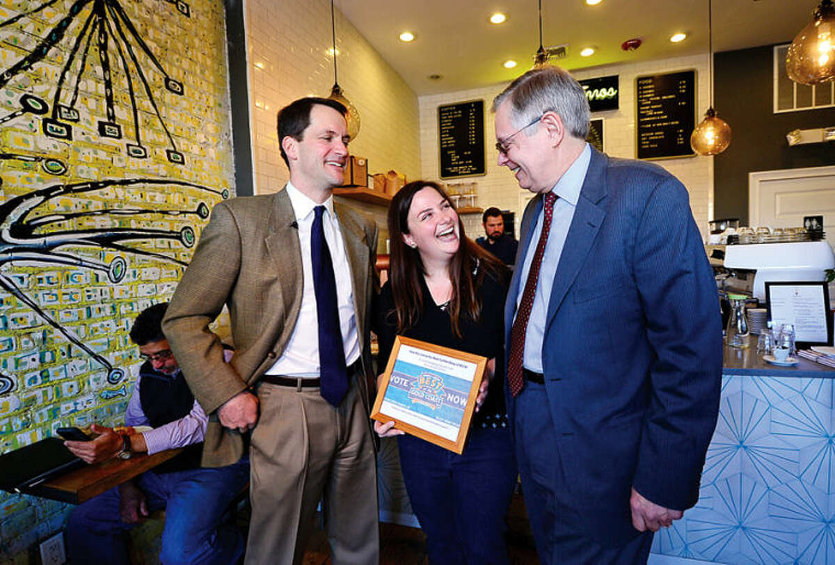 Hour photo / Erik Trautmann Congressman Jim Himes (CT-4) joins Stamford Mayor David Martin for a visit to Lorca, an artisan coffee shop run by Leyla Dam, an immigrant from Spain who opened her shop in January 2013.