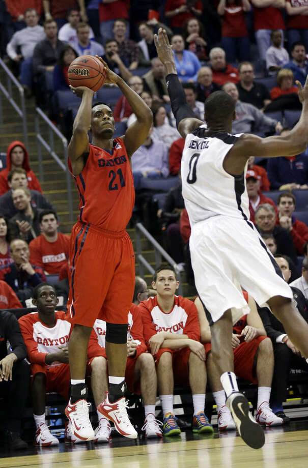 Dayton's Dyshawn Pierre (21) shoots over Providence's Ben Bentil (0) in the second half of an NCAA tournament college basketball game in the Round of 64 in Columbus, Ohio, Saturday, March 21, 2015. (AP Photo/Tony Dejak)