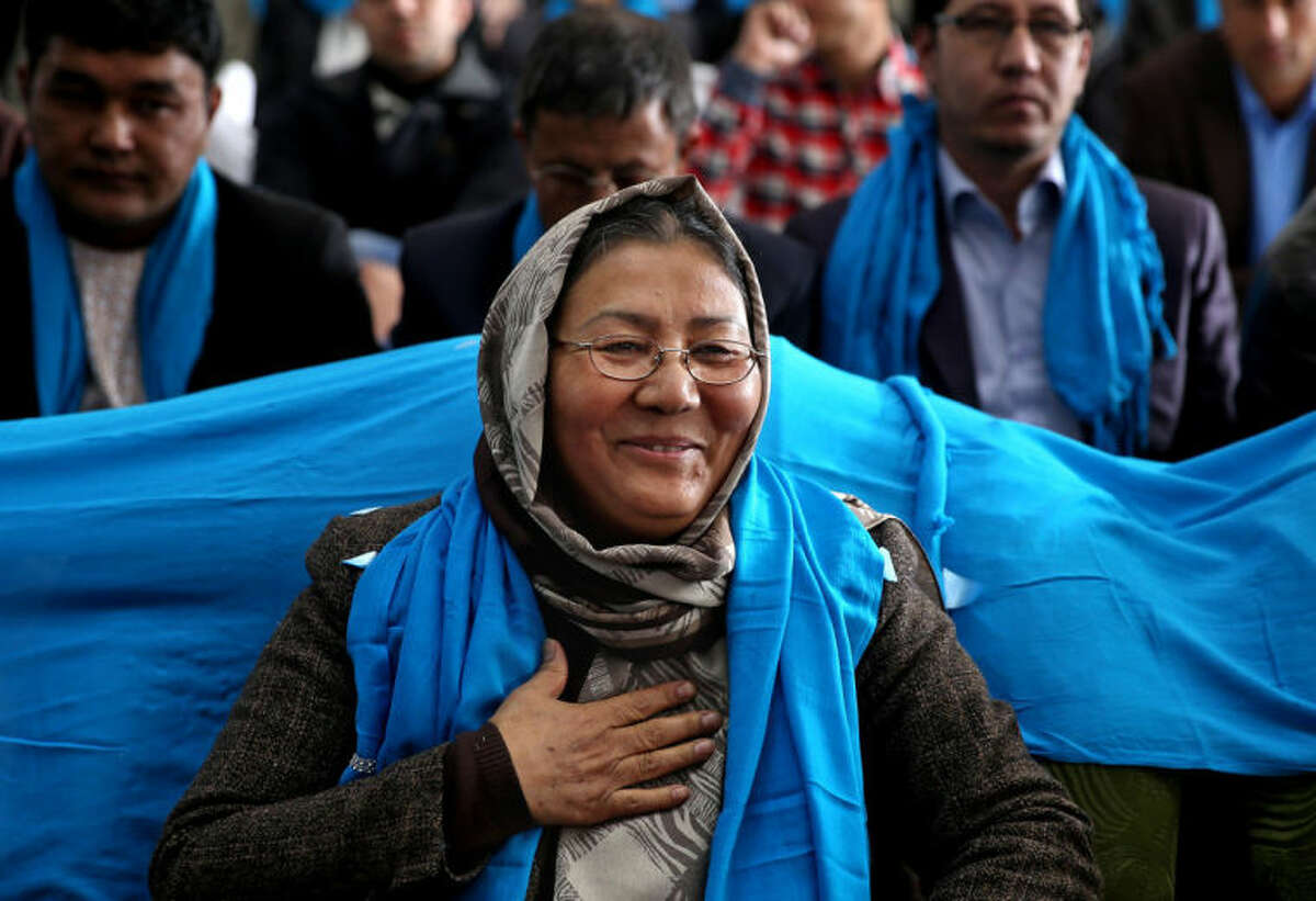 In this photo taken on Monday, March 17, 2014, Afghan vice presidential candidate, Habiba Sarabi, greets her supporters during a campaign rally in Kabul, Afghanistan. Sarabi, who already has been the first female governor in Afghanistan, is the most prominent woman running on a ticket in the April 5 election that will mark the first democratic transfer of power since the 2001 U.S.-led invasion that ousted the Taliban. But she faces cultural norms in this deeply conservative Islamic society. (AP Photo/Massoud Hossaini)
