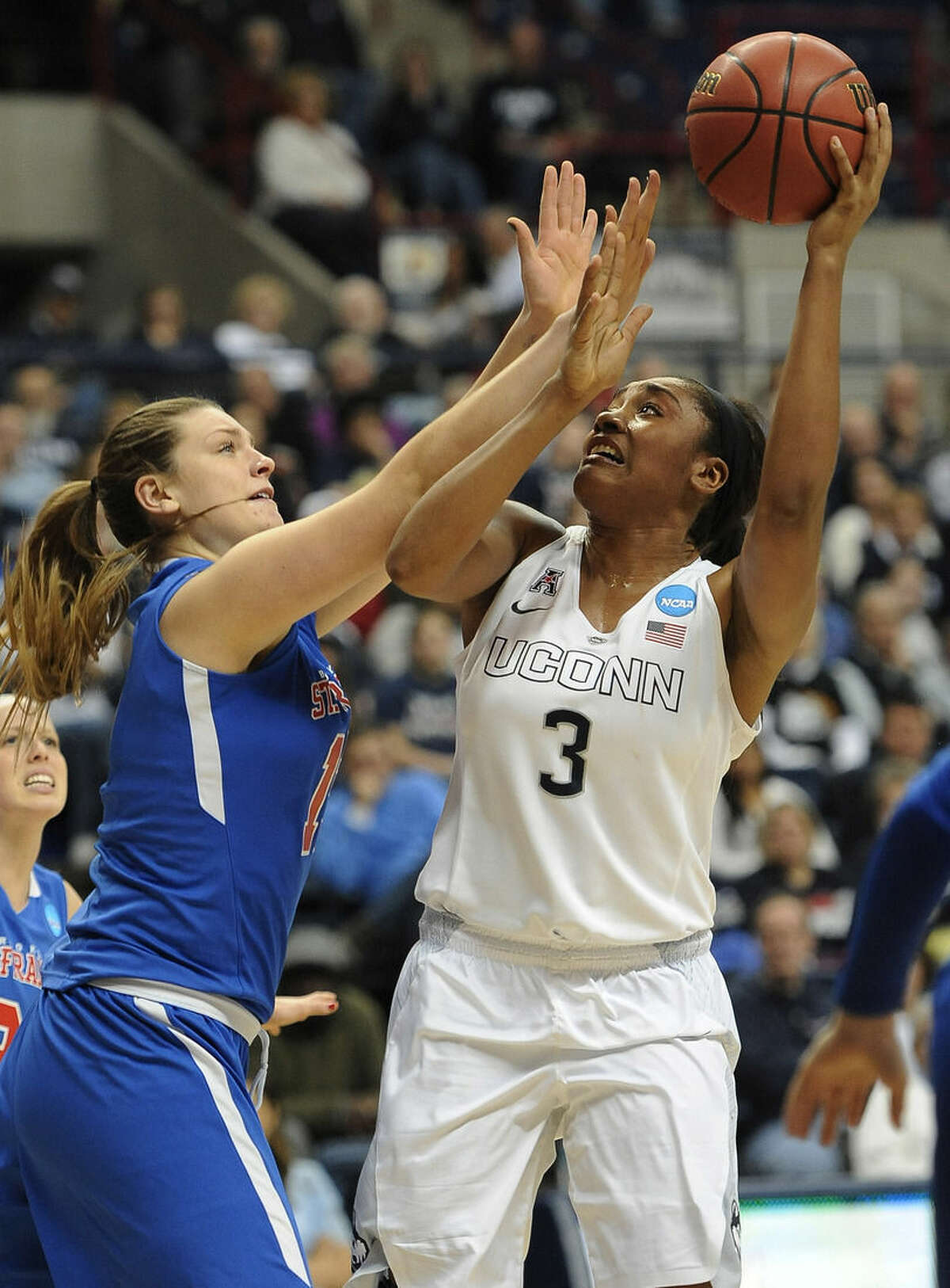Connecticut's Morgan Tuck, right, shoots over St. Francis' Olivia Levey , left, during the second half of a women's college basketball game in the first round of the NCAA tournament, Saturday, March 21, 2015, in Storrs, Conn. (AP Photo/Jessica Hill)