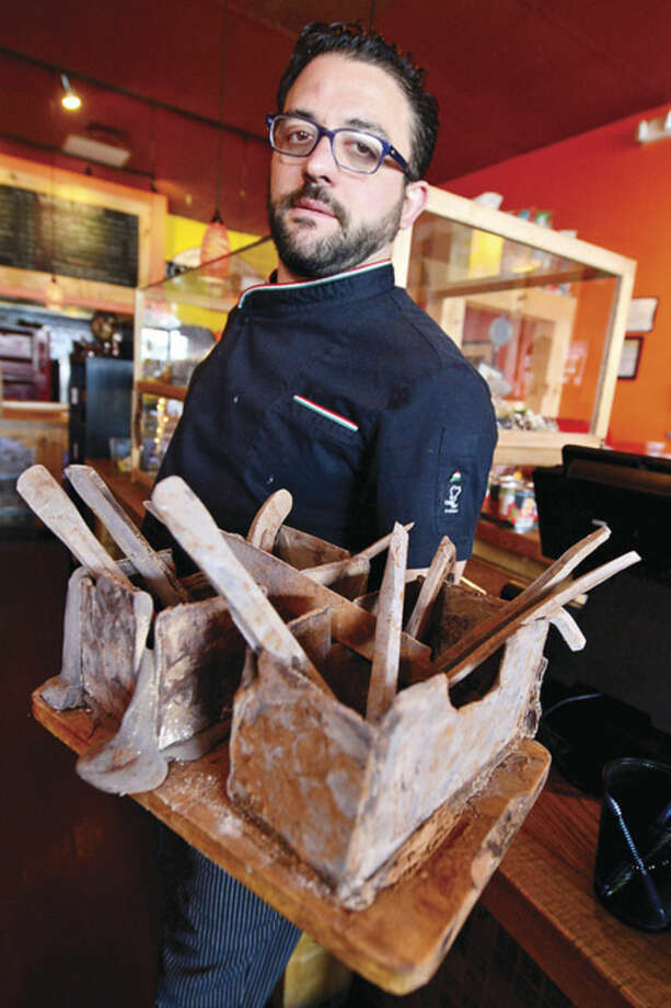 Hour photo / Erik TrautmannRomanacci's pizza restaurant owner, Graziano Ricci, makes hand-crafted chocolate tools, including hammers, wrenches, and bolts, that are a favorite among his customers.