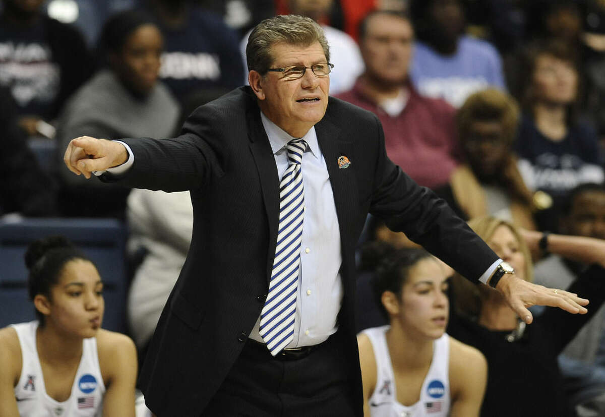 Connecticut Geno Auriemma gestures to his team during the first half of a women's college basketball game against St. Francis NY in the first round of the NCAA tournament, Saturday, March 21, 2015, in Storrs, Conn. (AP Photo/Jessica Hill)
