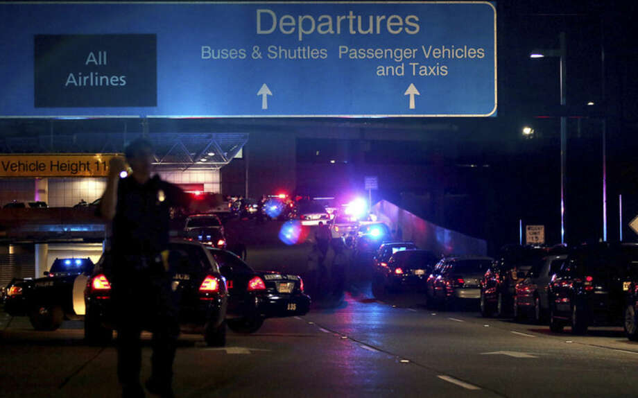 The ramp to departures is seen blocked off by emergency vehicles at the New Orleans International Airport, Friday, March 20, 2015, in Kenner, La. Richard White sprayed a TSA agent in the face with wasp killer then slashed a second guard with a machete before a third agent shot him three times at a security checkpoint in the New Orleans international airport Friday. (AP Photos/Jonathan Bachman)