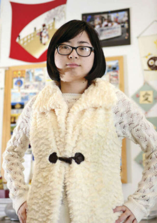 Hour photo / Erik Trautmann Brien McMahon High School student Karen Zheung, who is one of 8 regional finalists in a national speech contest will be presenting her speech at the United Nations in Japanese on Monday.