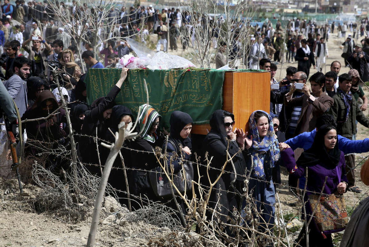 Afghan women rights activists carry the coffin of 27-year-old Farkhunda, an Afghan woman who was beaten to death by a mob, during her funeral, in Kabul, Afghanistan, Sunday, March 22, 2015. Hundreds of people gathered in northern Kabul for the funeral of Farkhunda, who like many Afghans is known by only one name. She was killed late Thursday by a mob of mostly men who beat her, set her body on fire and then threw it into the Kabul River, according to police accounts. Police are still investigating what prompted the mob assault. (AP Photo/Massoud Hossaini)