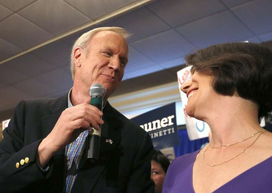 Bruce Rauner, left, thanks his wife Diana as they celebrate Rauner becoming the Republican gubernatorial candidate after he defeated the field of State Treasurer Dan Rutherford, State Sen. Kirk Dillard, and State Sen. Bill Brady, Tuesday, March 18, 2014, in Chicago. (AP Photo/Charles Rex Arbogast)