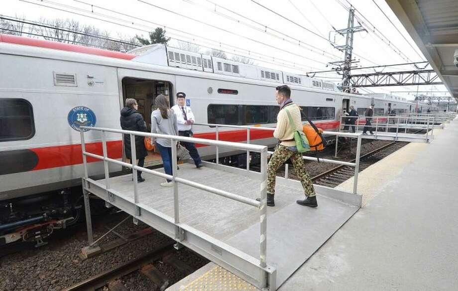 Hour Photo/Alex von Kleydorff Passengers board a Metro North train in Westport on Wednesday morning headed for Grand Central Terminal