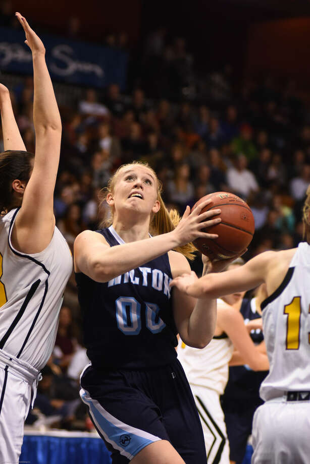 Hour photo/John Nash - Action from Saturday's CIAC Class LL girls basketball championship game between Wilton and South Windsor.