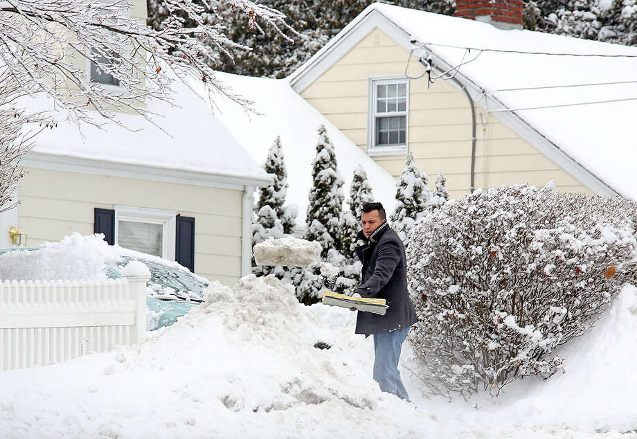 In this file photo, a man shovels his driveway on Tierney Street in Norwalk after the snow storm Sunday morning. Hour Photo / Danielle Calloway