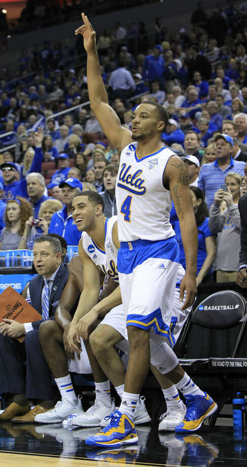 UCLA guard Norman Powell celebrates as the clock winds down during the second half of an NCAA tournament third round college basketball game in Louisville, Ky., Saturday, March 21, 2015. UCLA won the game 92-75. (AP Photo/David Stephenson)