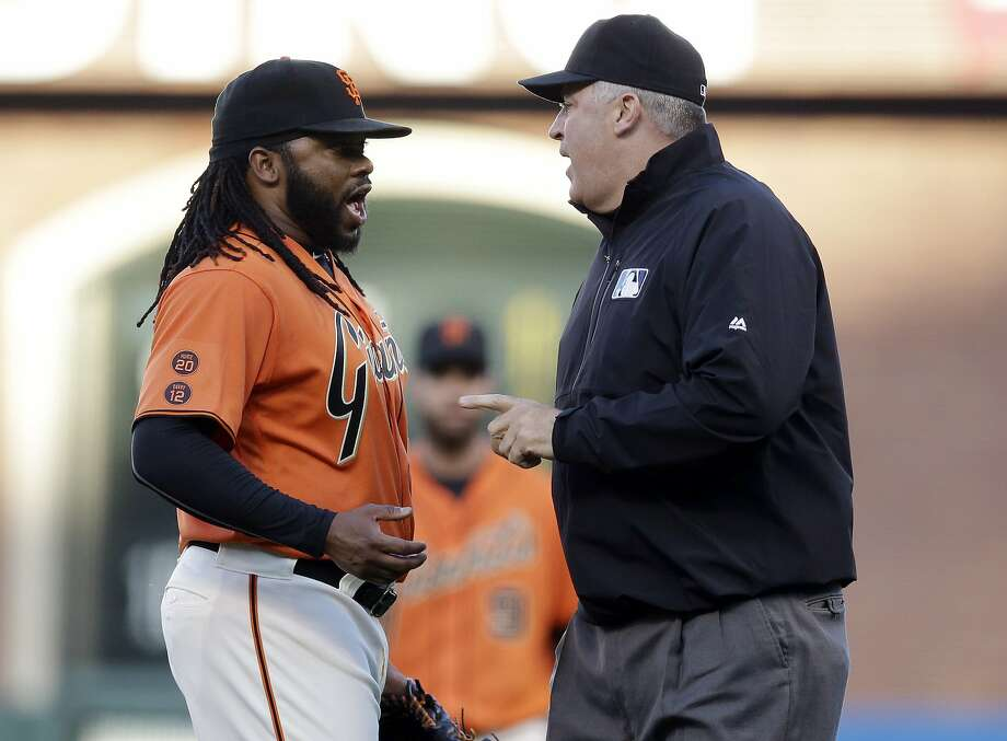 Johnny Cueto argues with umpire Bill Welke after a first-inning balk allowed the Dodgers to score a run. Photo: Marcio Jose Sanchez, Associated Press