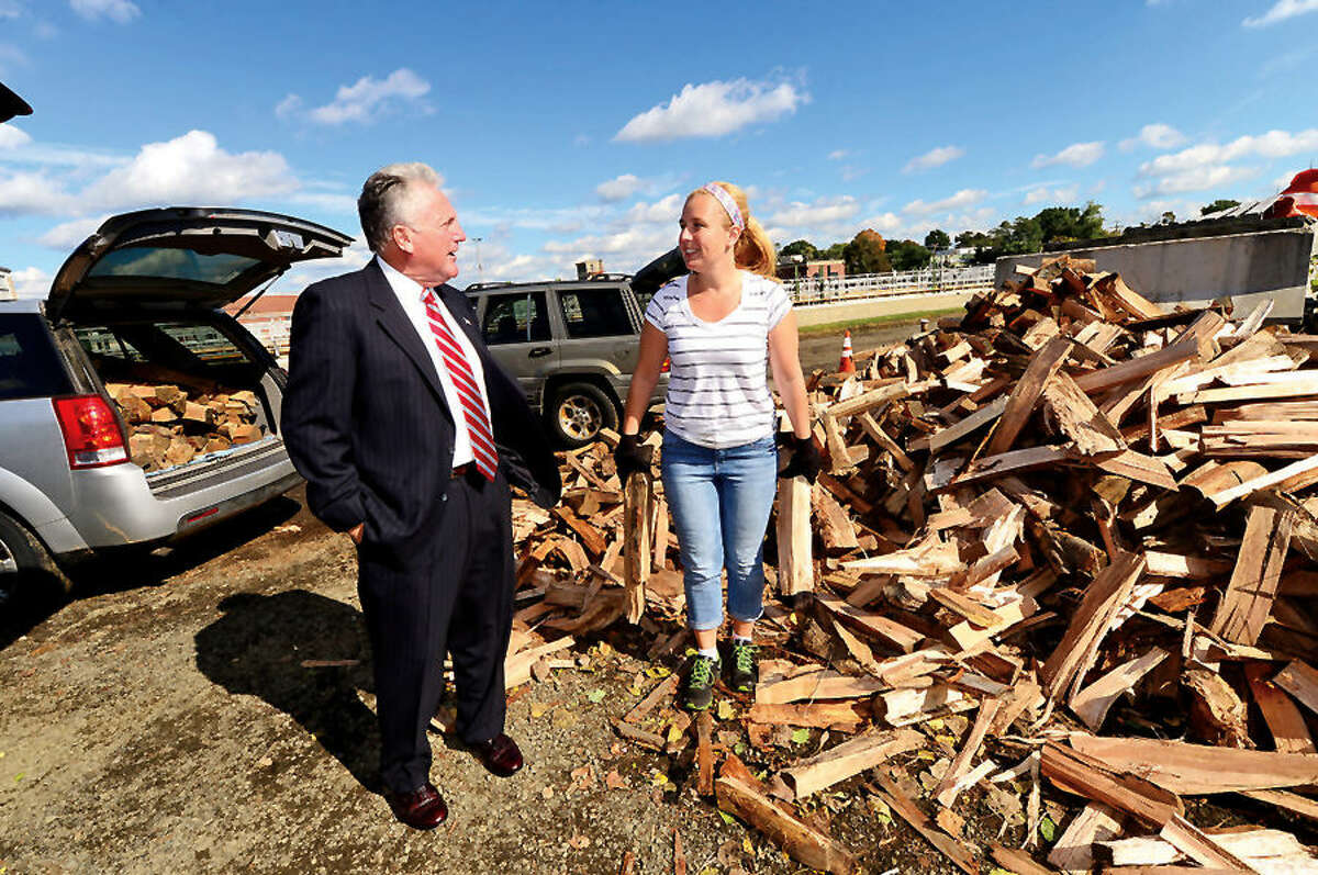 Hour photo / Erik Trautmann In this file photo, Norwalk Mayor Harry Rilling chats with resident Jennifer Merritt as he visited the Department of Public Works Yard Waste Debris Site on South Smith St. Wednesday in honor of the unprecedented success of the City of Norwalk's new Resident Firewood Program. The first set of firewood vouchers had sold out online in 11 minutes on Monday morning. The Energy and Environment Task Force started the program in conjunction with the Recreation and Parks Department.