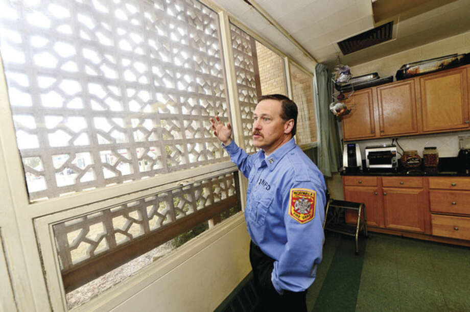 Hour photo / Erik Trautmann Norwalk Fire Captain Michel McCallum talks about what improvements will be made during renovations to Broad River Station No. 1 at 90 New Canaan Ave. later this year. Reallocation of $934,000 leftover from new headquarters construction will pay for the work.