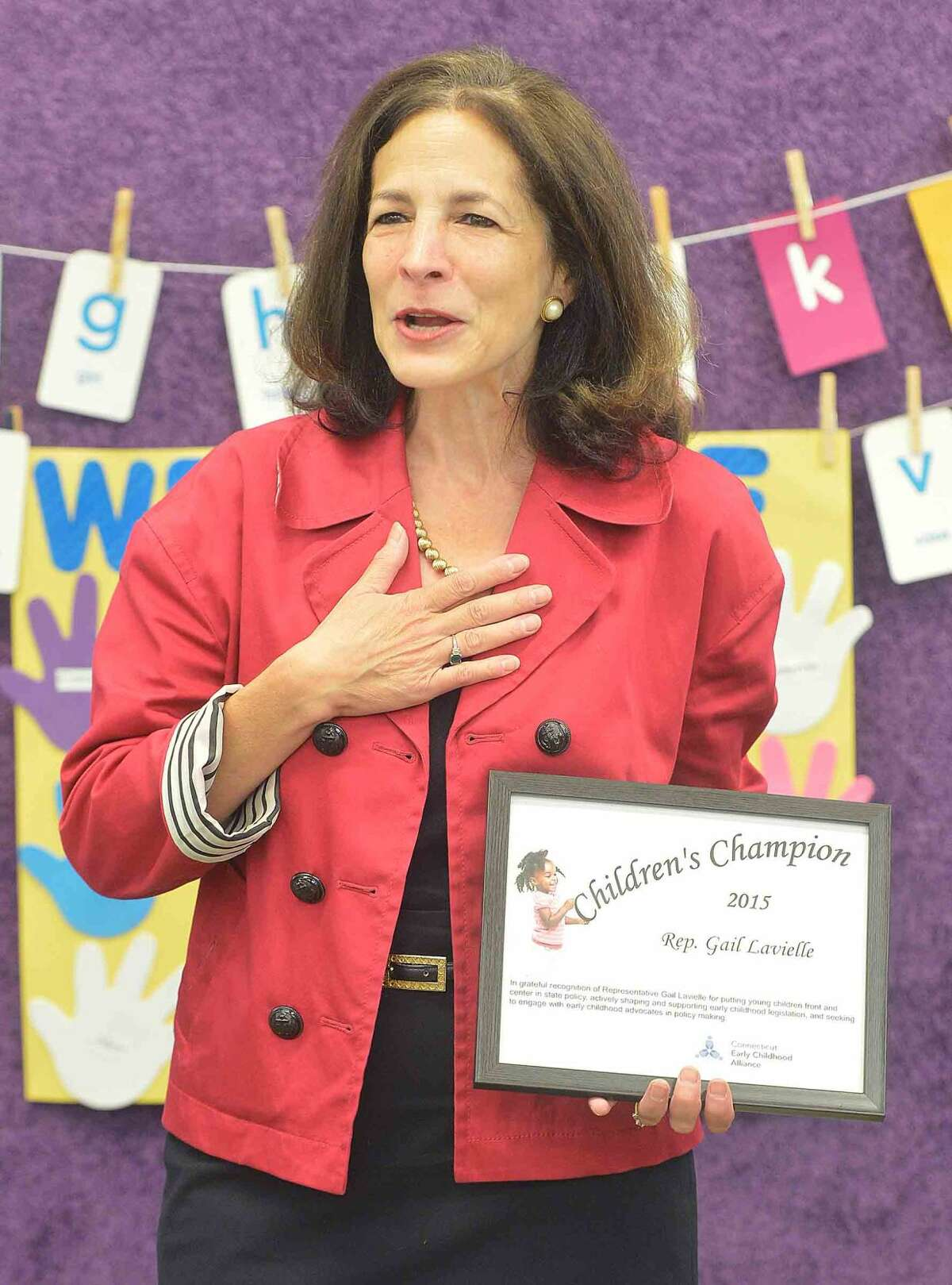 Hour Photo/Alex von Kleydorff In this file photo, State Rep Gail lavielle accepts a Childrens Champion award at the Naramake Family Resource Center