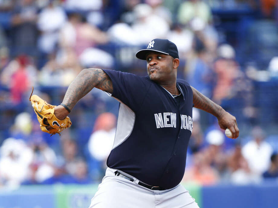 New York Yankees starting pitcher CC Sabathia works in the first inning of an exhibition spring training baseball game against the New York Mets, Sunday, March 22, 2015, in Port St. Lucie, Fla. (AP Photo/John Bazemore)