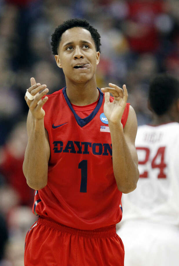 Dayton's Darrell Davis celebrates in the second half of an NCAA tournament college basketball game against Oklahoma in the Round of 32 in Columbus, Ohio, Sunday, March 22, 2015. (AP Photo/Paul Vernon)