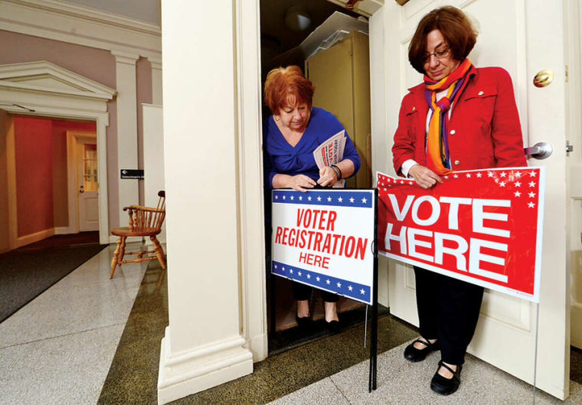 Democratic Registrar Carole Young-Kleinfeld and Republican Registrar Tina Gardner ready signage for the upcoming municipal elections at the Wilton Registrar of Voters Office in this file photo.