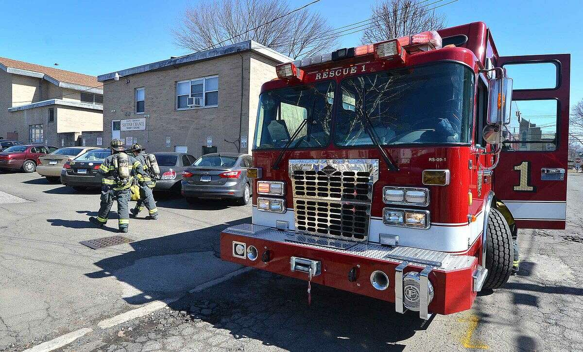 Hour Photo/Alex von Kleydorff Firefighters respond to a report of a gas leak at Room to Grow Preschool on East Ave Monday morning