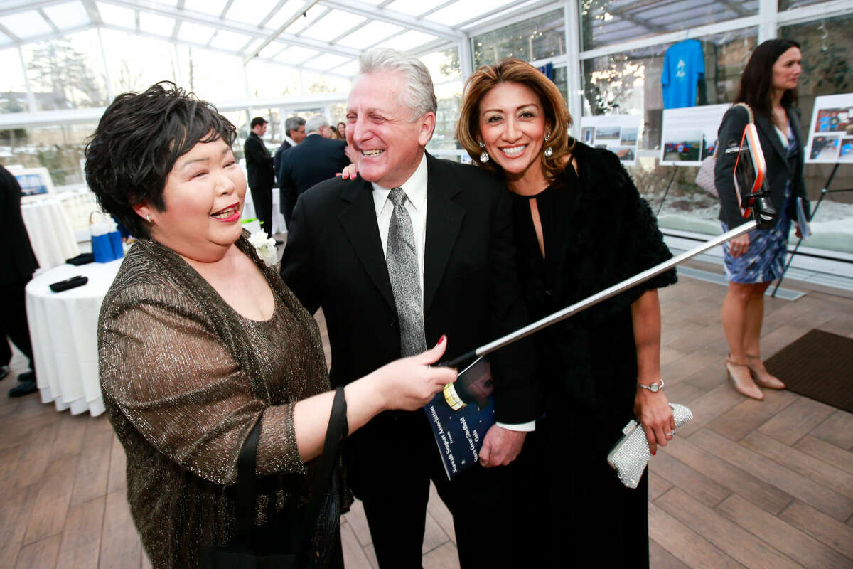 Hour photo/Chris Palermo Irene Dixon takes a selfie with Mayor Harry Rilling and his wife Lucia at the Norwalk Seaport Association annual Lightkeeper's Gala at the Norwalk Inn Saturday night.