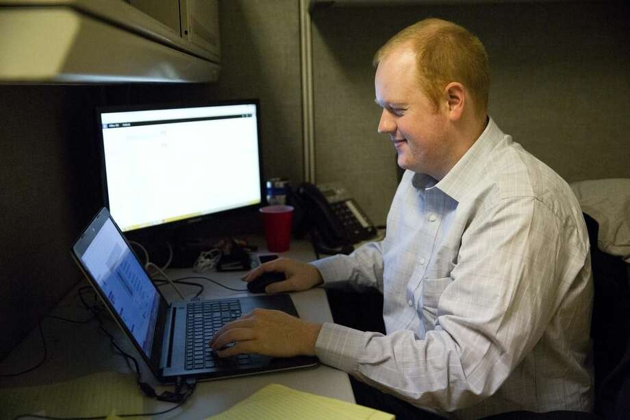 In this Feb. 24, 2015, photo, Baseball Info Solutions research analyst Scott Spratt works in Coplay, Pa. The company is a supplier of baseball data and analytics. (AP Photo/Matt Rourke)
