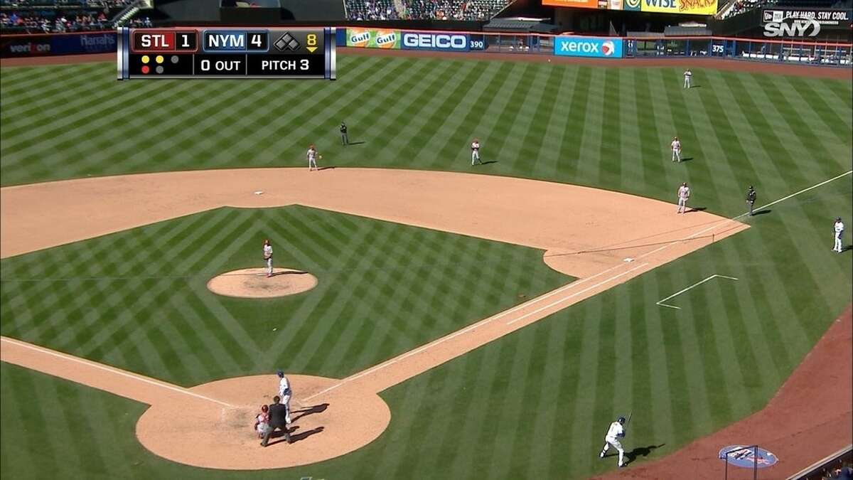 In this April 24, 2014, image provided by SportsNet New York, the St. Louis Cardinals shift to the right with New York Mets' Lucas Duda at bat in the eighth inning of a baseball game in New York. Duda hit a two-hopper to second baseman Mark Ellis _ who was perfectly positioned about 15 feet into right field and threw to first for the easy out. Duda estimates shifts dropped his average about 20 points last season.(AP Photo/SportsNet New York)