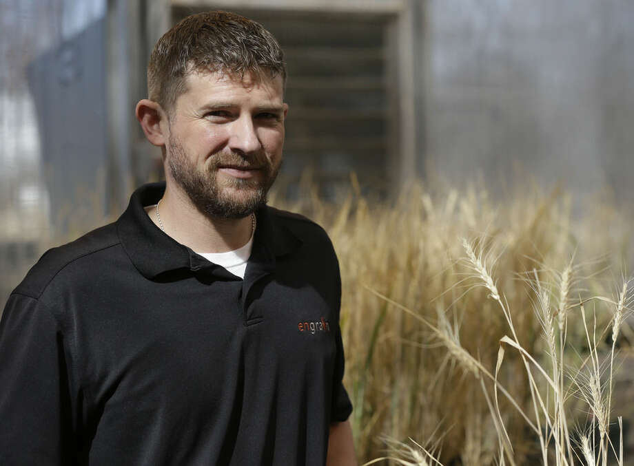 Chris Miller, senior director of research for Engrain, stops for a photograph during a tour of his research facility at the Wheat Innovation Center in Manhattan, Kan., Wednesday, March 11, 2015. (AP Photo/Orlin Wagner)