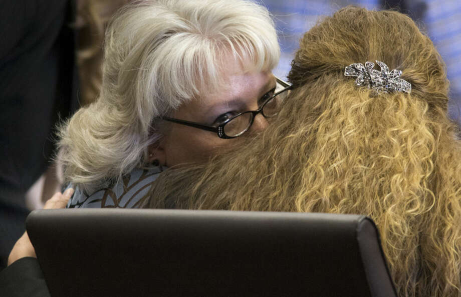 Debra Milke, left, talks with her attorney, Lori Voepel during a hearing, Monday, March 23, 2015, in Marcopa County Superior Court in Phoenix. Judge Rosa Mroz dismissed murder charges Monday against Milke without prejudice and ordered a probation officer to remove a monitoring device from her ankle. Milke, 51, spent 23 years on Arizona death row for the December 1989 murder of her four-year-old son, Christopher. (AP Photo/The Arizona Republic, Mark Henle) MARICOPA COUNTY OUT; MAGS OUT; NO SALES