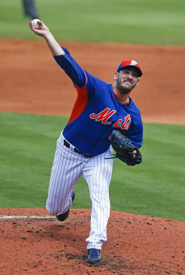 New York Mets starting pitcher Matt Harvey works in the second inning of an exhibition spring training baseball game against the New York Yankees, Sunday, March 22, 2015, in Port St. Lucie, Fla. (AP Photo/John Bazemore)