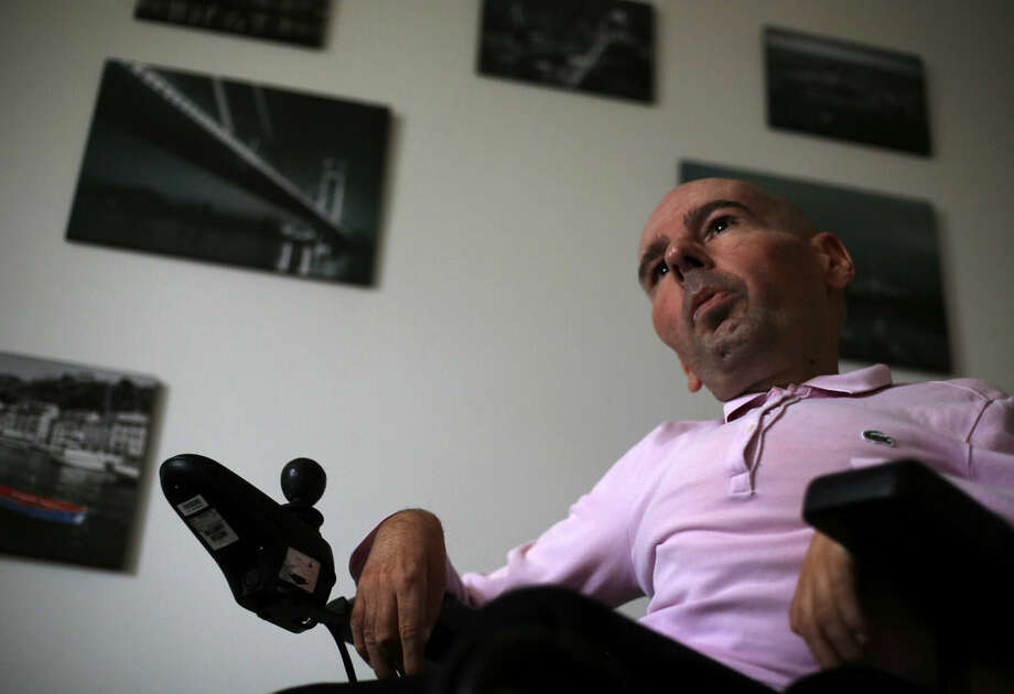In this photo taken Monday, March 2, 2015, Nenad Mihailovic speaks during an interview with The Associated Press in Belgrade, Serbia. Nenad Mihailovic flouts Serbian taboo. He's openly gay in a country notorious for strident homophobia. He uses a wheelchair in a society that shows little sympathy for the disabled. And he's a voice of liberal thinking in a nation where strong leaders have a tendency to quash dissent. (AP Photo/Darko Vojinovic)
