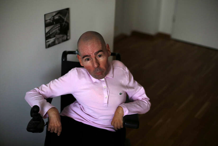 In this photo taken Monday, March 2, 2015, Nenad Mihailovic speaks during an interview with The Associated Press in Belgrade, Serbia. Nenad Mihailovic flouts Serbian taboo. He's openly gay in a country notorious for strident homophobia. He uses a wheelchair in a society that shows little sympathy for the disabled. And he's a voice of liberal thinking in a nation where strong leaders have a tendency to quash dissent.(AP Photo/Darko Vojinovic)