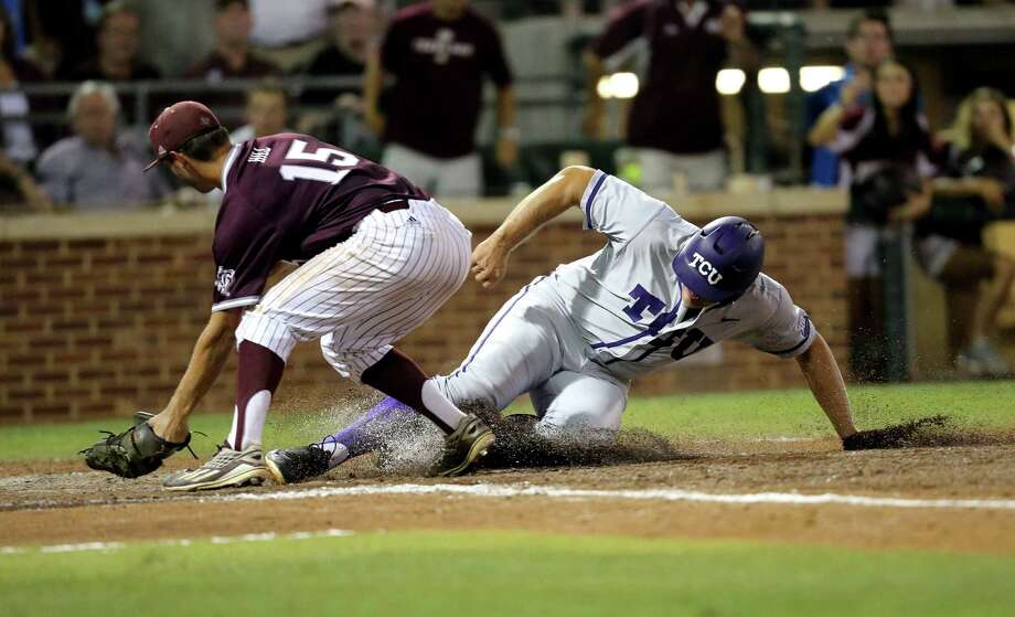 TCU's Luken Baker (19) is called safe at home after a wild pitch as Texas A&M's Brigham Hill (15) tries to apply a tag during the fifth inning of an NCAA Super Regional baseball tournament game, Friday, June 10, 2016, in College Station, Texas. (AP Photo/Sam Craft) Photo: Sam Craft, Associated Press / AP