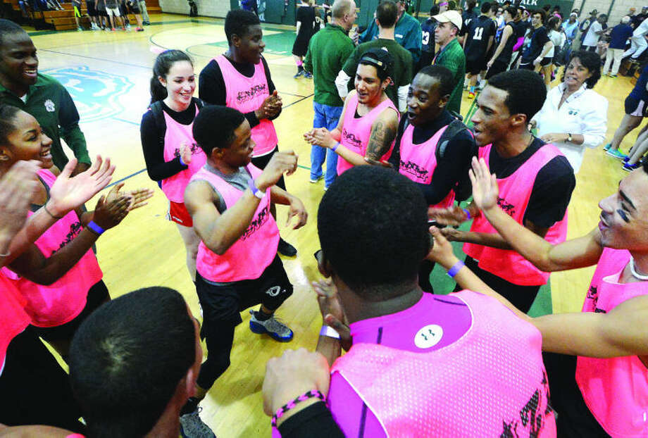Hour Photo/Alex von Kleydorff. Team 'ZiZi' warms up before their match at Norwalk High Schools Dodgeball fundraiser