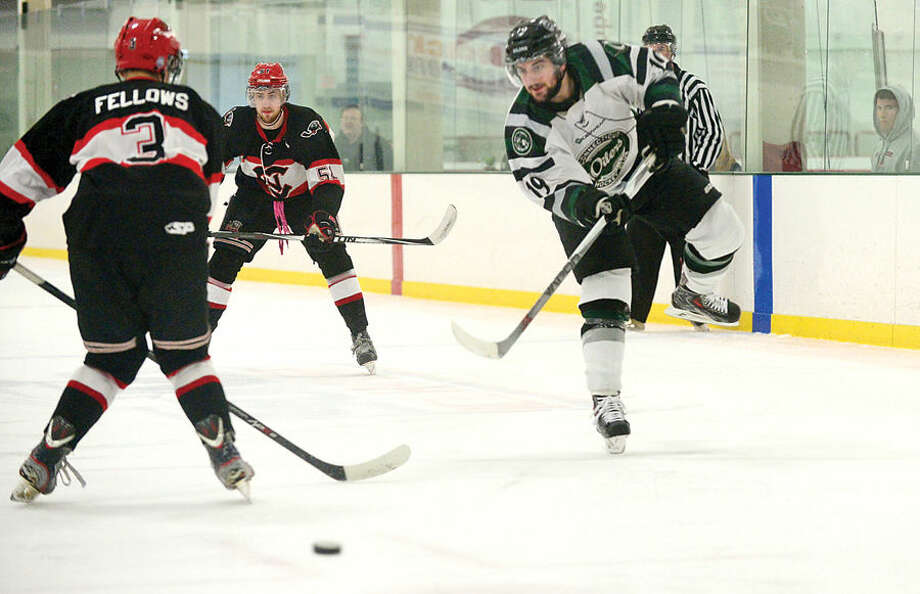 Hour photo / Erik Trautmann CTOilers #19 Joe Pizzimenti shoots past I. J. Fellows as the Oilers host the Northeern Cyclones in game four of the Best of 5 EHLchampionship series Tuesday.