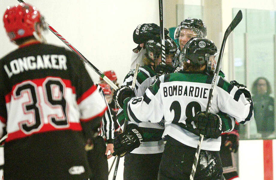 Hour photo / Erik Trautmann CTOilers celebrate a goal as they host the Northeern Cyclones in game four of the Best of 5 EHLchampionship series Tuesday.