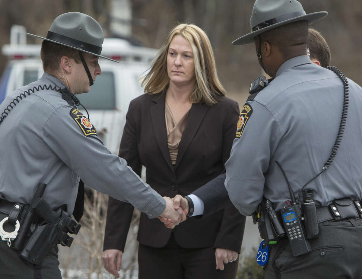 Hummelstown, Pa., Police officer Lisa Mearkle walks into District Judge Lowell A. Witmer's office in West Hanover Twp., Tuesday, March 24, 2015, for her preliminary arraignment in connection with the shooting death of David Kassick during a traffic stop in February 2015. She was charged with criminal homicide, and is being held without bail over the Feb. 2 shooting. Investigators say Mearkle had incapacitated Kassick with a stun gun and he was on the ground when she shot him twice. She told investigators she thought he was reaching into his jacket for a gun.(AP Photo/PennLive.com, Mark Pynes)