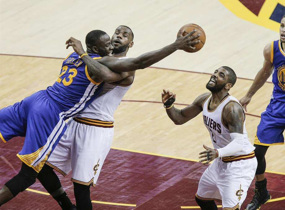 Golden State Warriors' Draymond Green and Cleveland Cavaliers' LeBron James fight for a rebound in the fourth quarter during Game 4 of the NBA Finals at The Quicken Loans Arena on Friday, June 10, 2016 in Cleveland, Ohio. Photo: Carlos Avila Gonzalez, The Chronicle