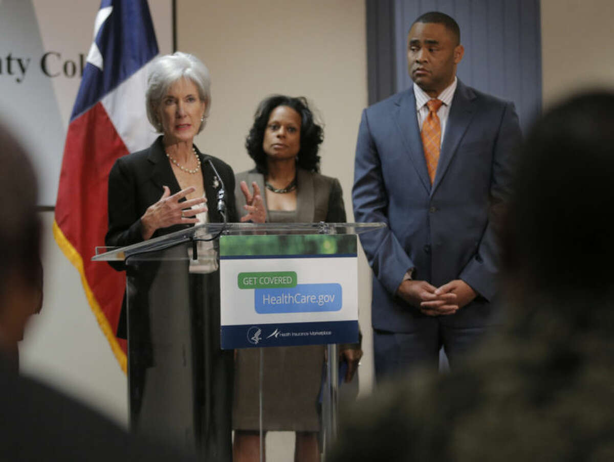 U.S. Secretary of Health and Human Services Kathleen Sebelius speaks at a news conference to encourage people to sign up for health insurance under the Affordable Care Act, at Tarrant County College South, Thursday, March 20, 2014 in Fort Worth, Texas. Behind Sebelius are State Representative Nicole Collier and U.S. Representative Marc Veasey. (AP Photo/The Fort Worth Star-Telegram, Rodger Mallison) MAGS OUT; (FORT WORTH WEEKLY, 360 WEST); INTERNET OUT