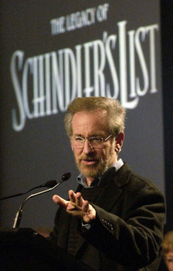 "FILE - In this March 3, 2004 file photo, Steven Spielberg, director of the 1993 World War II epic ""Schindler's List,"" speaks at a news conference at Universal Studios in Universal City, Calif. Spielberg was inspired to create the Shoah Foundation after meeting so many Holocaust survivors while making ""Schindler's List,"" which tells the story of a German businessman who used his Nazi ties to rescue 1,100 Jews from the Holocaust. The film's greatest legacy isn't its seven Oscars, $300 million in worldwide box office or even its message of humanity, says the 67-year-old, Spielberg, but the ongoing work of the Shoah Foundation. (AP Photo/Reed Saxon, file)"