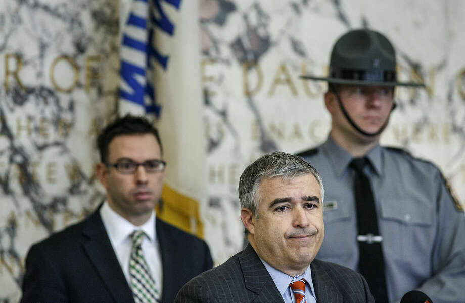 Dauphin County District Attorney Ed Marsico speaks, while Deputy District Attorney John Baer, left, and state police spokesman Trooper Robert Hicks stand behind him, during a news conference Tuesday, March 24, 2015, in Harrisburg. Pa., regarding the shooting death of an unarmed man after a traffic stop by police. Authorities filed the charge of criminal homicide Monday, against 36-year-old Hummelstown Police Office Lisa Mearkle, saying she shot David Kassick twice in the back as he lay facedown on the ground. (AP Photo/PennLive.com, Dan Gleiter)
