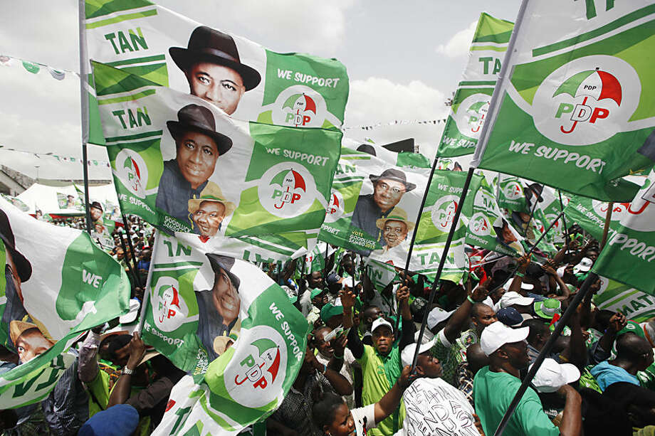 Supporters of Nigeria President, Goodluck Jonathan, attends an election campaign rally at the National stadium in Lagos, Nigeria, Tuesday, March. 24, 2015. Nigeria goes to the polls Saturday to elect a new President. (AP Photo/Sunday Alamba)